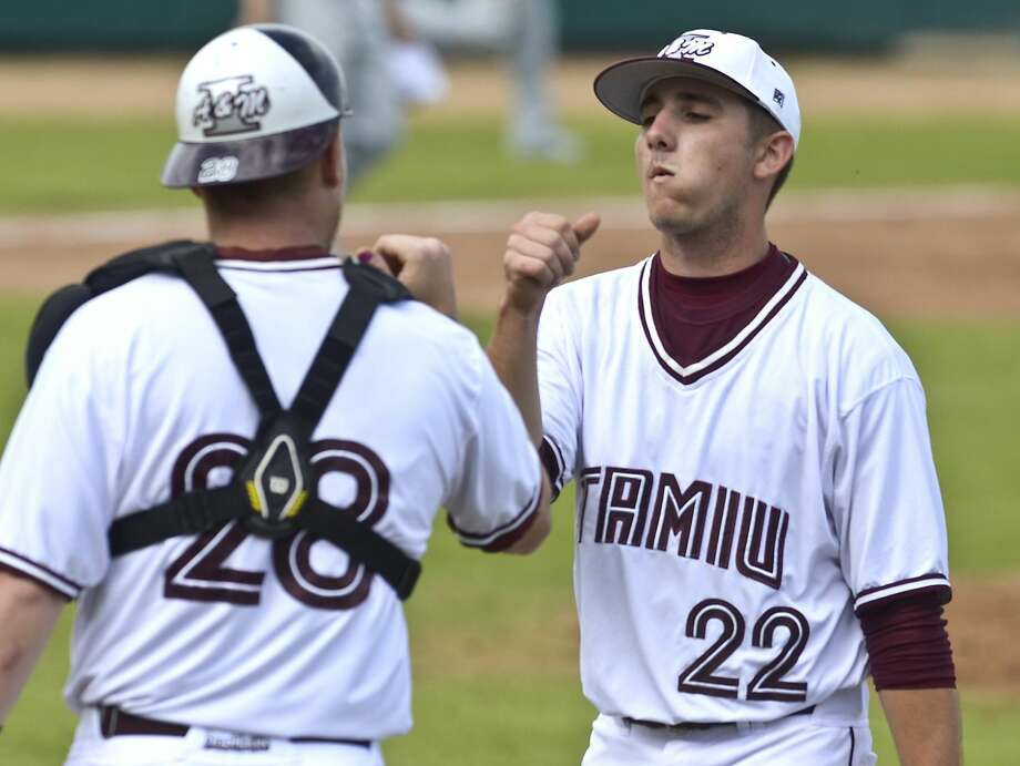 The Texas A&M International Dustdevils are off to a historic start to their 2013 season, a perfect 8-0 after sweeping a doubleheader at Uni-Trade Stadium today against Arlington Baptist. In this photo, TAMIU's catcher Sean Smedley (28) and pitcher Jared Curnel (22) fist bump after getting the third out of the inning against Arlington Baptist College. (Photo by Cuate Santos