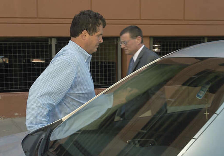 Steven Aiello, left, the president of COR Development, gets into an waiting car outside the Federal courthouse in Syracuse , New York, Thursday, Sept. 22, 2016. Two owners of COR Development Co., Aiello and Joseph Girardi, face federal corruption charges in U.S. Attorney Preet Bharara's investigation into economic development projects in Upstate New York. Aiello and Gerardi are accused of bribing a former top aide to Gov. Andrew Cuomo. (Dennis Nett/syracuse.com via AP)