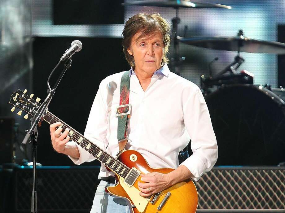 This Dec. 12, 2012 file image released by Starpix shows Paul McCartney at the 12-12-12 The Concert for Sandy Relief at Madison Square Garden in New York. McCartney and Mumford & Sons are among the headliners for the 2013 Bonnaroo Music & Arts Festival in Manchester, Tenn. The four-day festival, held on a rural 700-acre farm, will be held June 13-16, 2013. (AP Photo/Starpix, Dave Allocca, file)