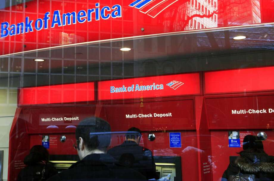 In this Jan. 31, 2011 photo, Bank of America customers use ATM machines in New York. Truly free checking accounts are becoming rarer as banks add more fees to boost their profits. Financial data publisher Bankrate.com says a survey shows only 39 percent of non-interest checking accounts are free to all customers. That's down from 45 percent last year and 76 percent in 2009. (AP Photo/Mark Lennihan)