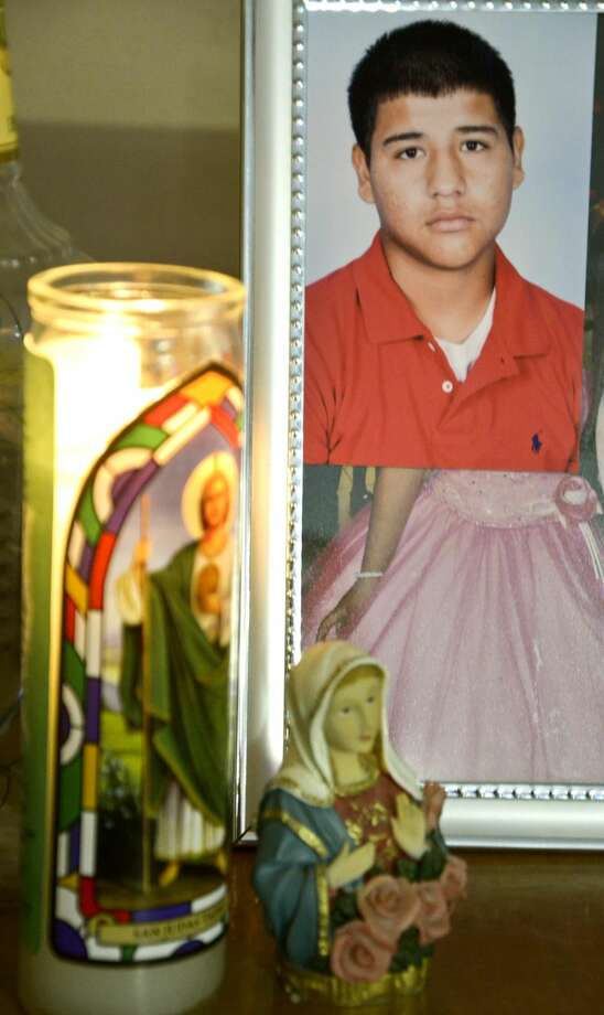 A photo of 16-year-old Bruni High School student Oscar Ramos, who died Feb. 20, can be seen next to a makeshift altar Friday, Feb. 22, at the family store/home in Mirando City. (Cuate Santos/Laredo Morning Times)