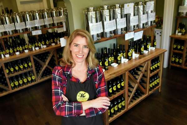 Shop owner Erin Popeleski on Friday, Oct. 21, 2016, at Evergreen Olive Oil Co. in Niskayuna, N.Y. (Cindy Schultz / Times Union)
