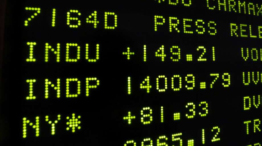 A board at the New York Stock Exchange shows the closing number for the Dow Jones industrial average, Friday, Feb. 1, 2013. The Dow stock market index closed above 14,000 for the first time since before the financial crisis rocked the world economy. It's gained 6.9 percent this year. (AP Photo/Richard Drew)