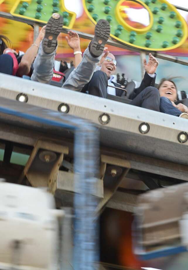 WBCA President Bob Weathers, left, and Nidia Weathers react while riding the Moby Dick during opening day of the 2013 WBCA Carnival. The carnival is being held at the Laredo Energy Arena parking lot. (Photo by Danny Zaragoza/Laredo Morning Times)