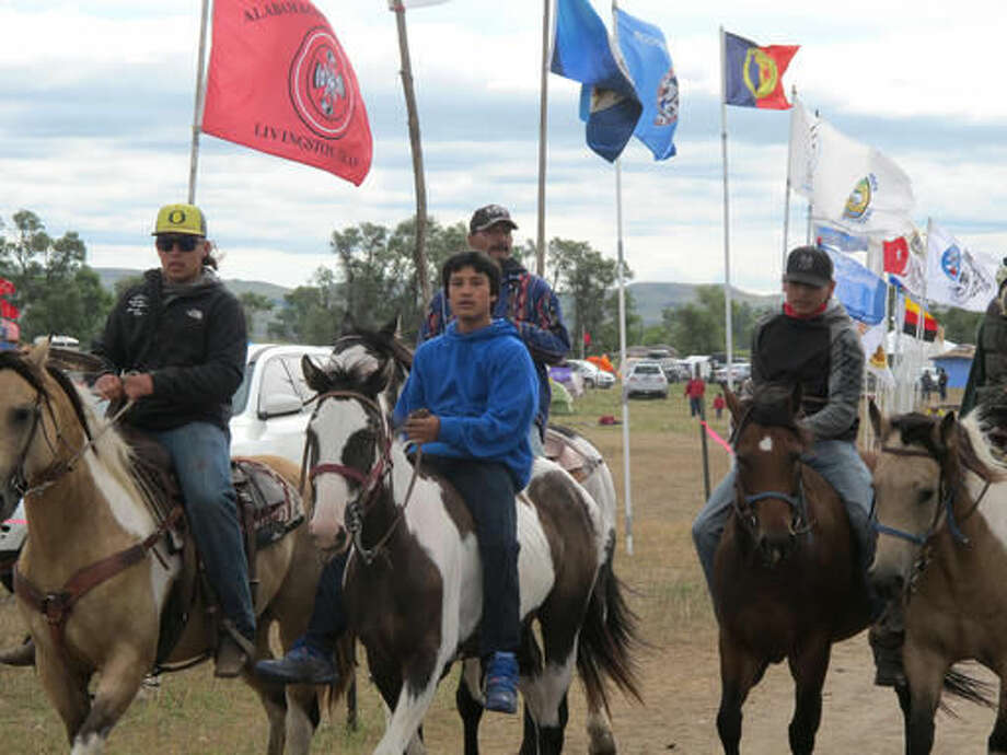 """Horseback riders make their way through an encampment near North Dakota's Standing Rock Sioux reservation on Friday, Sept. 9, 2016. The Standing Rock Sioux tribe's attempt to halt construction of an oil pipeline near its North Dakota reservation failed in federal court Friday, but three government agencies asked the pipeline company to """"voluntarily pause"""" work on a segment that tribal officials say holds sacred artifacts. (AP Photo/James MacPherson)"""