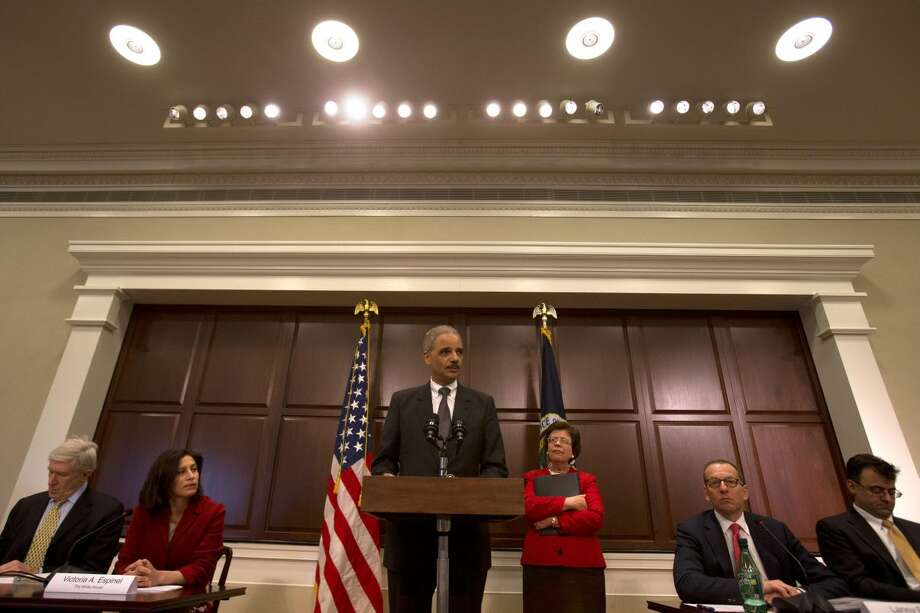Attorney General Eric Holder, center, speaks about strategy to mitigate the theft of U.S. trade secrets, Wednesday, Feb. 20, 2013, in the Eisenhower Executive Office building on the White House complex in Washington. From left are, Undersecretary of Stat Robert Hormats; U.S. Intellectual Property Enforcement Coordinator Victoria Espinel; Holder; Acting Commerce Deputy Secretary Rebecca Blank; Assistant Attorney General Lanny Breuer; and General Electric Vice President Karan Bhatia. (AP Photo/Jacquelyn Martin)