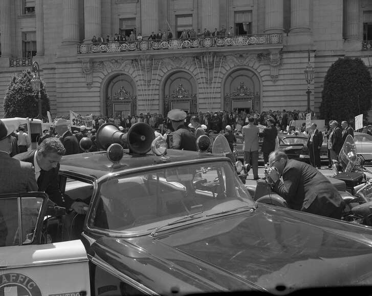 Friday May 13, 1960: Protest and sit-in against House Un-American Activities Committee (HUAC) at City Hall, San Francisco. Police evict protestors using a fire hose, washing them down the steps. Mayor George Christopher  Chronicle photographers Bob Campbell and Peter Breinig