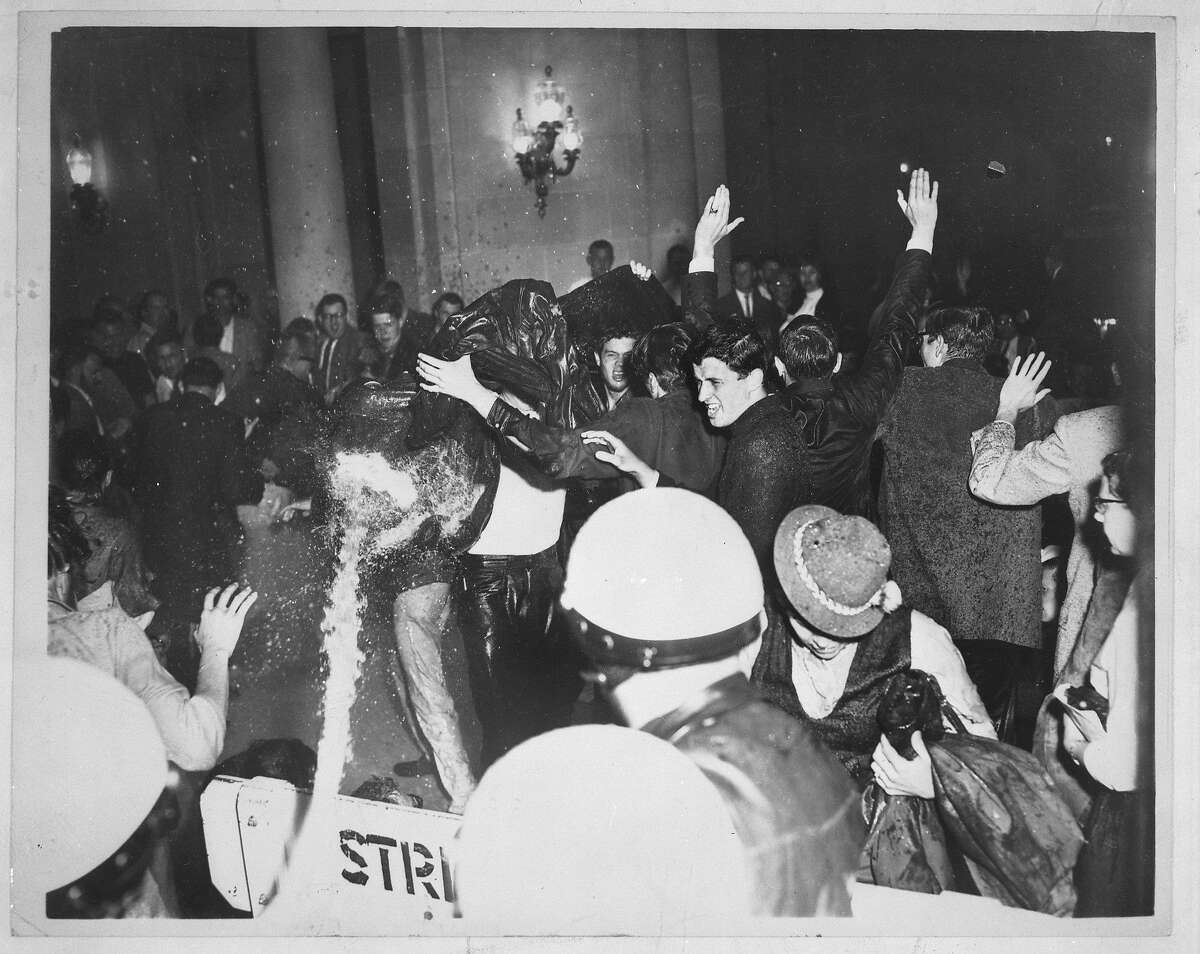 Friday May 13, 1960: Protest and sit-in against House Un-American Activities Committee (HUAC) at City Hall, San Francisco. Police evict protestors using a fire hose, washing them down the steps. Chronicle photographers Bob Campbell and Peter Breinig