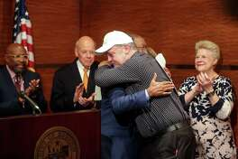 Jay Jeanjaquet, who was previously homeless, hugs Mayor Sylvester Turner during a press conference Thursday to announce a $1 million grant to help Houston's homeless population. ( Jon Shapley / Houston Chronicle )