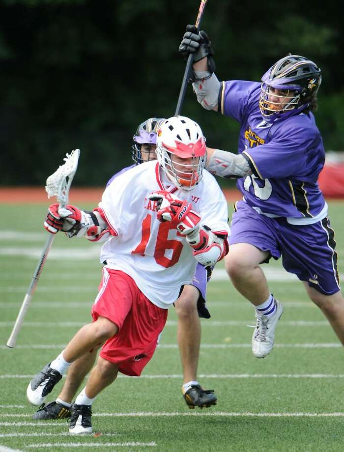 Greenwich High School's Jake Stein controls the ball with pressure from  Westhill High School's Tom McCartney and Mike Suchochi in boys lacrosse in Greenwich, Conn. on Saturday May 15, 2010. Photo: Kathleen O'Rourke / Stamford Advocate