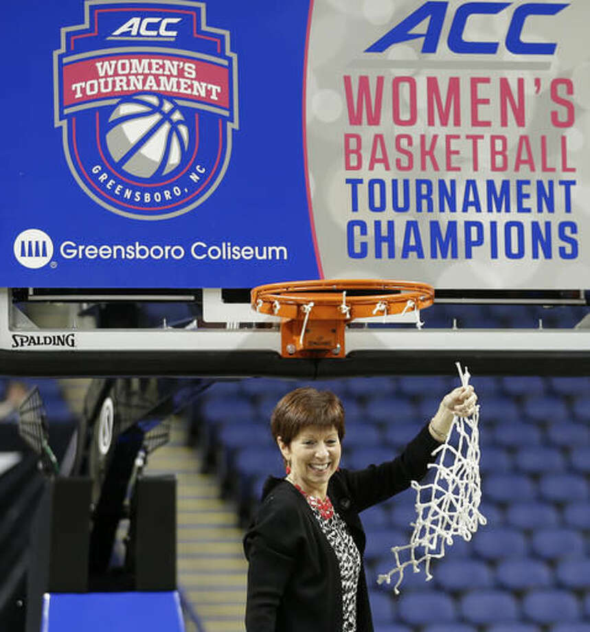 FILE - In this March 8, 2015, file photo, Notre Dame head coach Muffet McGraw celebrates after an NCAA college basketball game against Florida State in the championship of the Atlantic Coast Conference tournament in Greensboro, N.C. NCAA President Mark Emmert says it's up to the Atlantic Coast Conference and its members whether to follow the association's lead and pull events out of North Carolina because of a state law that some say can lead to discrimination against LGBT people. In an interview Tuesday, Sept. 13, 2016, with The Associated Press, Emmert said the association expects to take a financial hit for moving seven championship events and tournament games out of the state on short notice, but how much is unknown. (AP Photo/Chuck Burton, File)