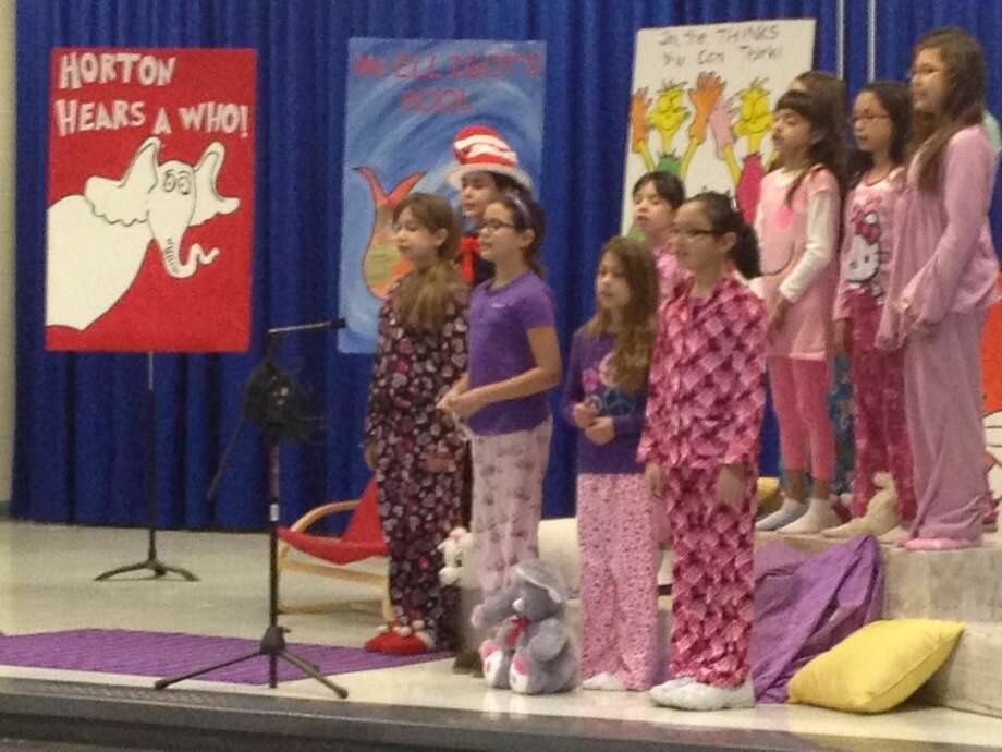 United Day School Choir members perform at the school gymnasium Tuesday morning as part of the Read Across America festivities. (Photo by: Cuate Santos