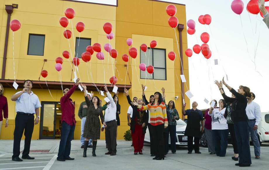 Friends and family of Vishal Buxani, who passed away on Feb. 14, 2012, release balloons with attached index cards imprinted with random acts of kindness that were performed by attendees this past year. The ceremony took place Wednesday afternoon outside the L&F Distributors building. (Photo by Danny Zaragoza/Laredo Morning Times)