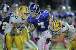 Trinity Chriss Ciacciarella and Arthur Yaniv make a stop on Fairfield Ludlowe Aiden Kudzy in a varsity football game at Fairfield Ludlowe High School in Fairfield on Friday, Oct. 21, 2016.