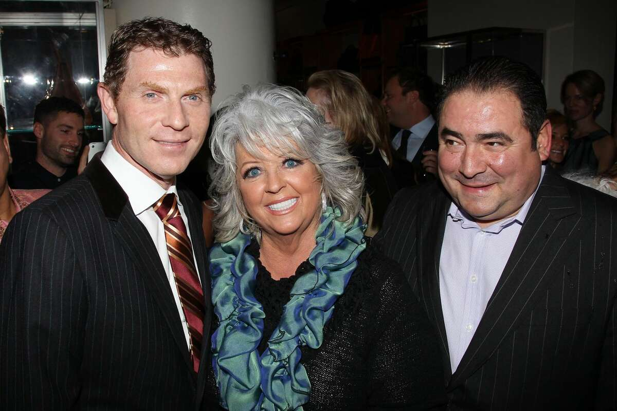 FILE - In this Nov. 16, 2010 file photo provided by StarPix, from left to right, celebrity chefs Bobby Flay, Paula Deen, and Emeril Lagasse from the Food Network attend the unveiling of Barneys New York food themed holiday windows in New York. It was revealed that Deen admitted during questioning in a lawsuit that she had slurred blacks in the past. It's the second time the queen of comfort food's mouth has gotten her into big trouble. She revealed in 2012 that for three years she hid her Type 2 diabetes while continuing to cook the calorie-laden food that's bad for people like her. The Food Network, which began airing