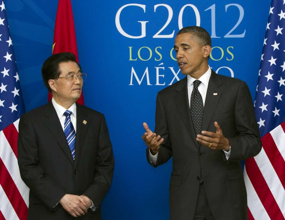 In this June 19, 2012 file photo, President Barack Obama speaks as he attends a bilateral meeting with China�s President Hu Jintao during the G20 Summit, in Los Cabos, Mexico. Citing national security risks, Obama on Friday, Sept. 28, 2012, blocked a Chinese company from owning four wind farm projects near a Navy base where the U.S. military flies unmanned drones and electronic-warfare planes on training missions. It was the first time in 22 years that a U.S. president has blocked such a foreign business deal. (AP Photo/Carolyn Kaster, File)