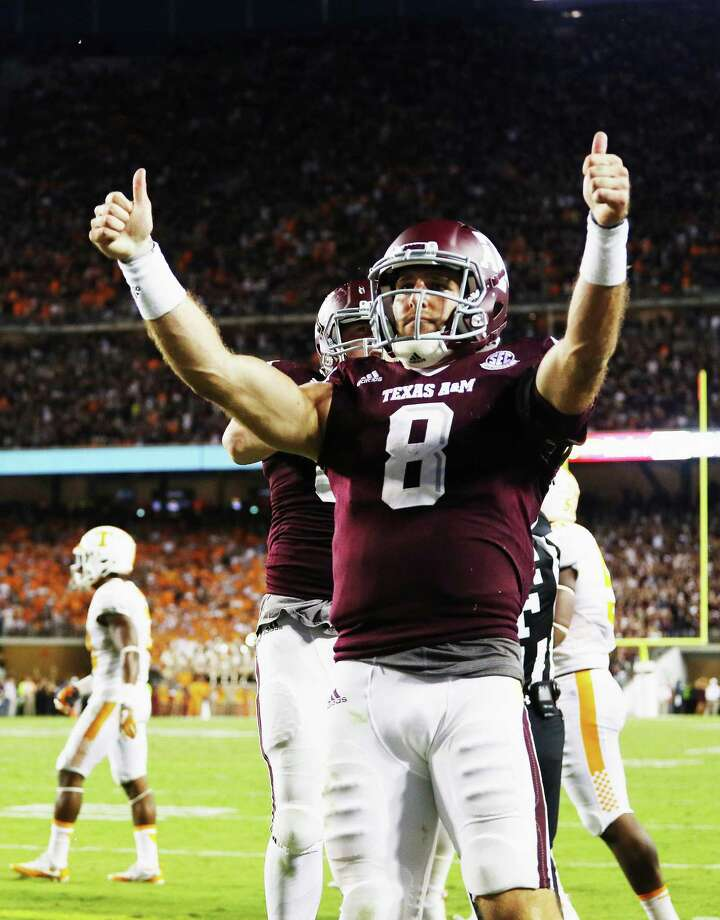 COLLEGE STATION, TX - OCTOBER 08:  Trevor Knight #8 of the Texas A&M Aggies celebrates after scoring a touchdown in the second overtime of their game against the Tennessee Volunteers at Kyle Field on October 8, 2016 in College Station, Texas.  (Photo by Scott Halleran/Getty Images) ORG XMIT: 668999605 Photo: Scott Halleran / 2016 Getty Images