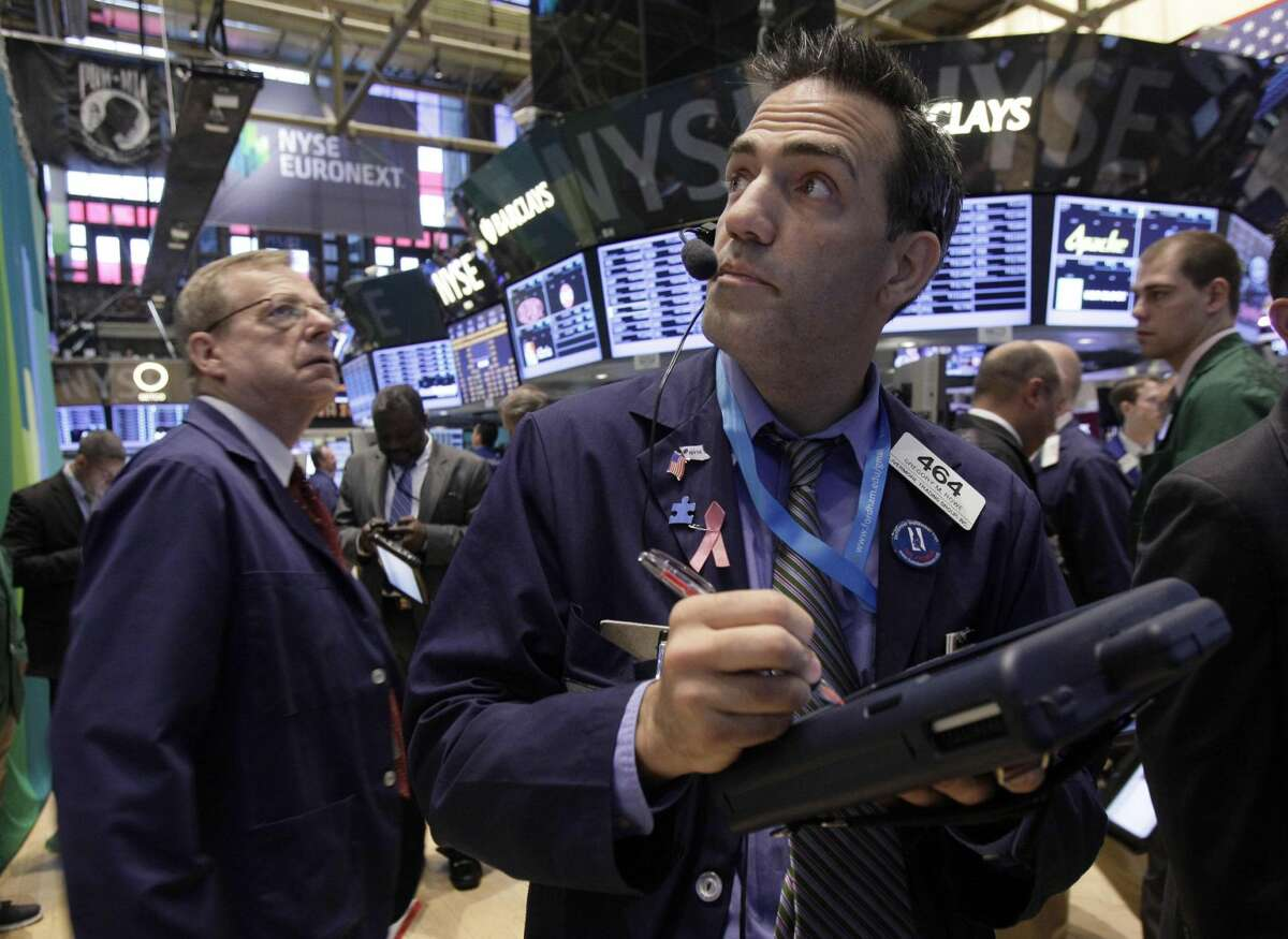 Trader Gregory Rowe, right, works on the floor of the New York Stock Exchange Friday, Sept. 7, 2012. Stocks are opening mixed on Wall Street following news that the U.S. economy added fewer jobs than expected in August. (AP Photo/Richard Drew)