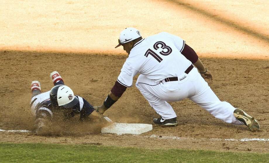 The Texas A&M International Dustdevils have entered their 2013 baseball season on fire, winning their first six games — all played at Uni-Trade Stadium and against Heartland Conference rivals. The previous program-best start was a 4-1 mark in 2012. The Dustdevils have swept three-game series from the University of Texas of the Permian Basin and Arkansas-Fort Smith. In this photo, Alex Salas (13) tags out an Oklahoma Panhandle State's Alfonso Gonzalez (11) Friday afternoon at Unitrade Stadium. (Photo by Danny Zaragoza