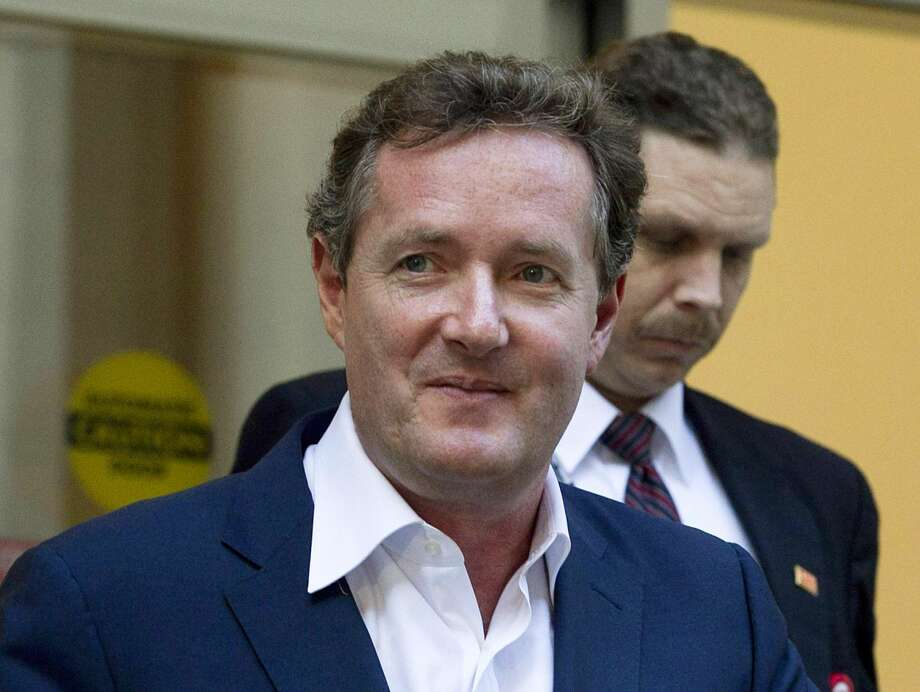"In this Dec. 20, 2011 file photo, Piers Morgan, host of CNN's ""Piers Morgan Tonight,"" leaves the CNN building in Los Angeles. More than 31,400 people have signed a petition calling for British CNN host Piers Morgan to be deported from the U.S. over his gun-control views. Morgan has taken an aggressive stand for tighter U.S. gun laws in the wake of the Newtown, Conn., school shooting. Last week, he called a gun advocate appearing on his ""Piers Morgan Tonight"" show an ""unbelievably stupid man."" Now, gun-rights activists are fighting back. A petition created Dec. 21 on the White House e-petition website by a user in Texas accuses Morgan of engaging in a ""hostile attack against the U.S. Constitution"" by targeting the Second Amendment and demands he be deported immediately. (AP Photo/Jae C. Hong, File)"
