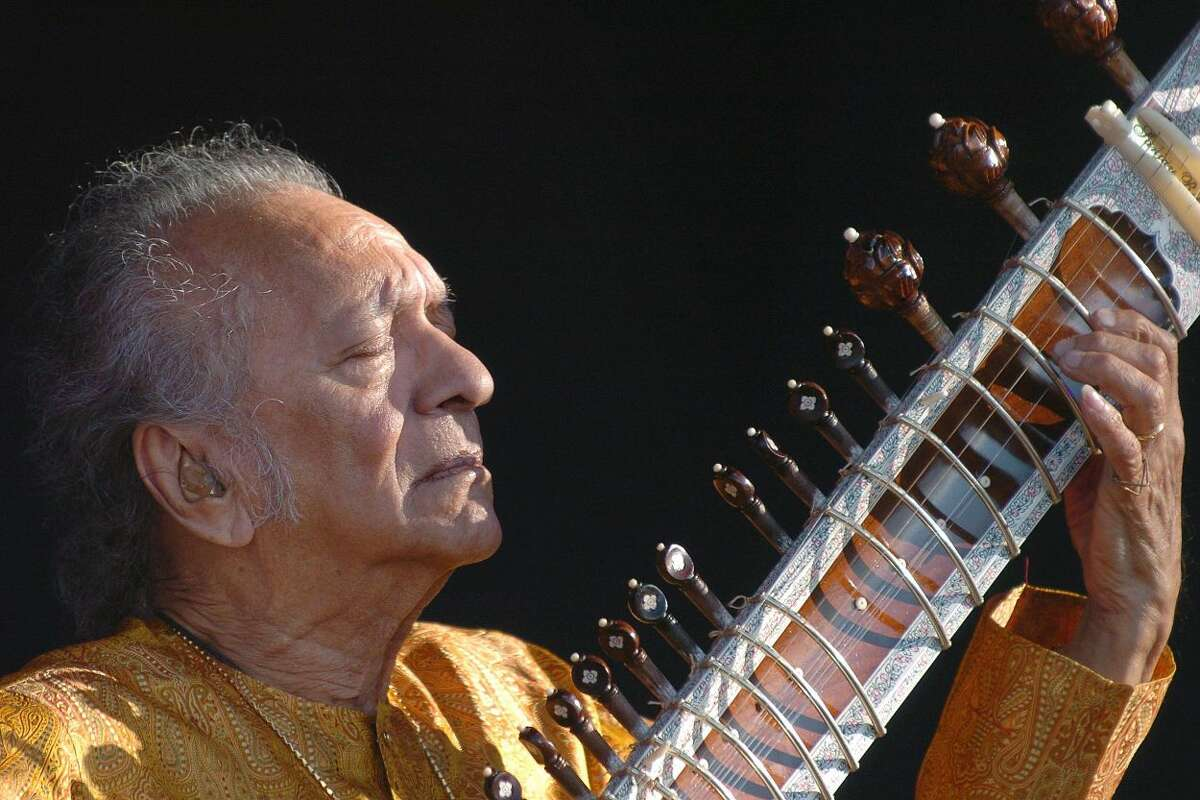 In this July 19, 2005 file photo, Indian musician Ravi Shankar performs during the opening day of the Paleo Festival, in Nyon, Switzerland. Shankar, the sitar virtuoso who became a hippie musical icon of the 1960s after hobnobbing with the Beatles and who introduced traditional Indian ragas to Western audiences over an eight-decade career, died Tuesday, Dec. 11, 2012. He was 92. (AP Photo/Keystone, Sandro Campardo, File)