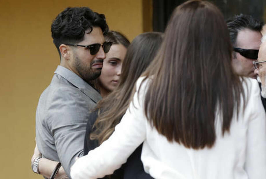 Washington Nationals pitcher Gio Gonzalez, left, arrives for a memorial service for Miami Marlins pitcher Jose Fernandez, at St. Brendan's Catholic Church, Thursday, Sept. 29, 2016, in Miami. Fernandez was killed in a boating accident Sunday along with two friends. (AP Photo/Lynne Sladky)