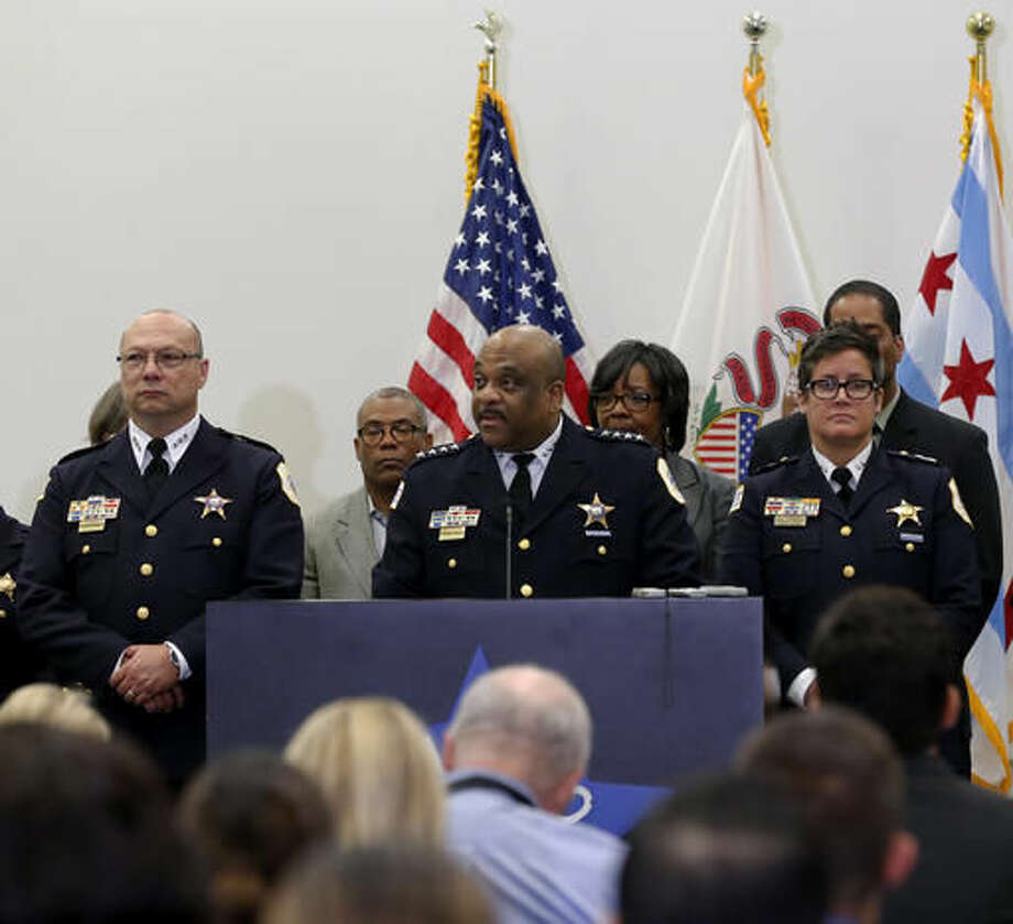 Chicago Police Superintendent Eddie Johnson, center, speaks during a news conference Wednesday, Sept. 21, 2016, in Chicago. Chicago's police department will add nearly 1,000 new positions over the next two years, Johnson announced Wednesday, saying it'll help the city deal with a dramatic increase in shootings and homicides. (AP Photo/Tae-Gyun Kim)