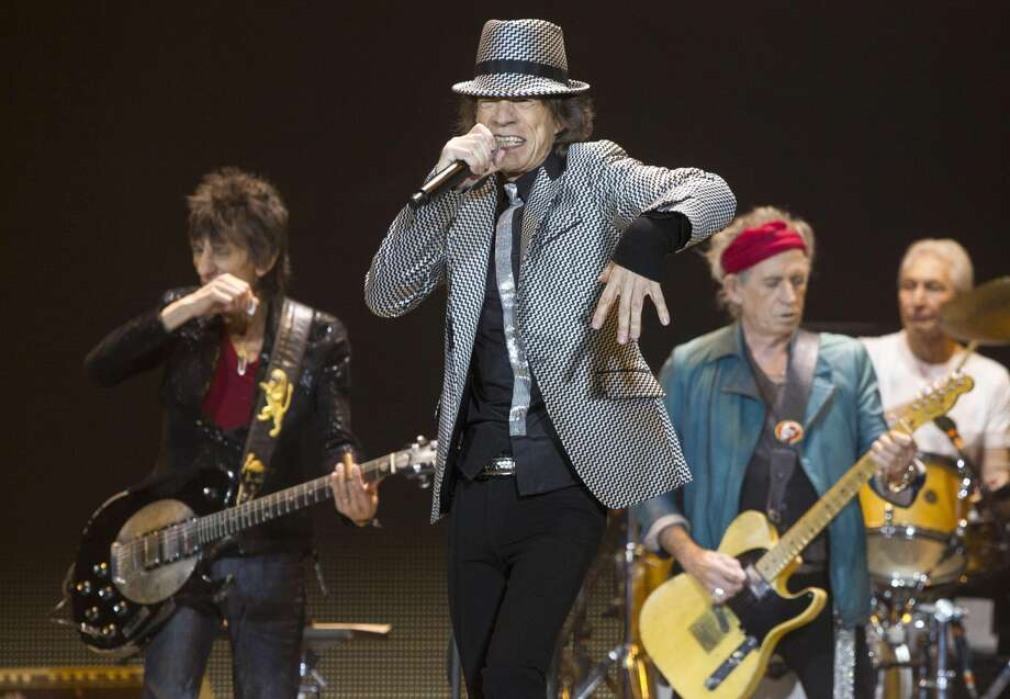 In this Nov. 25, 2012 file photo, Mick Jagger, center, Keith Richards, Ronnie Wood, left, and Charlie Watts, right, of The Rolling Stones perform at the O2 arena in east London. The Rolling Stones have been added to the list of artists performing at the 12-12-12 Hurricane Sandy benefit concert next week in New York City. Producers of the show said Friday, Dec. 7, 2012, had already raised $30 million that will be distributed to storm victims through the Robin Hood Foundation. The show is sold out. (Photo by Joel Ryan/Invision/AP)