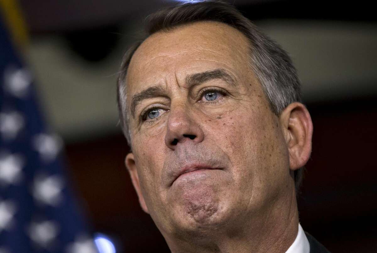 Speaker of the House John Boehner, R-Ohio, speaks to reporters about the fiscal cliff negotiations at the Capitol in Washington, Friday, Dec. 21, 2012. Hopes for avoiding the
