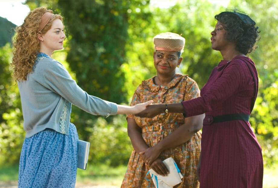 """From left, Emma Stone, Octavia Spencer and Viola Davis are shown in a scene from """"The Help."""" """"The Help"""" continues to clean up at the box office, taking over the No. 1 spot with $20.5 million in its second weekend. (AP Photo/Disney, Dale Robinette)"""