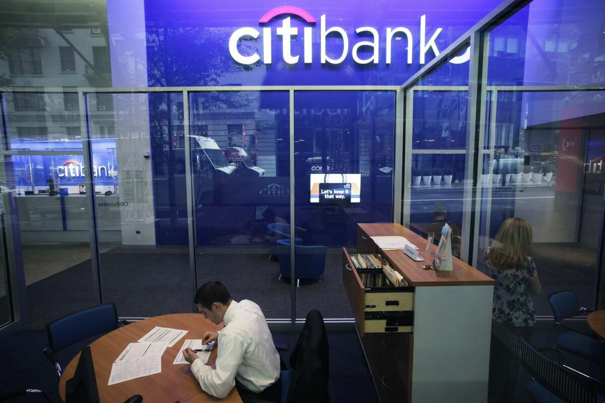 This Oct. 13, 2011 file photo, shows a Citibank branch in New York. Citigroup said Wednesday, Dec. 5, 2012, that it will cut 11,000 jobs, a bold early move by new CEO Michael Corbat. The cuts amount to about 4 percent of Citi's workforce of 262,000. The bulk of the cuts, about 6,200, will come from Citi's consumer banking unit, which handles everyday functions like branches and checking accounts. (AP Photo/Mark Lennihan, File)