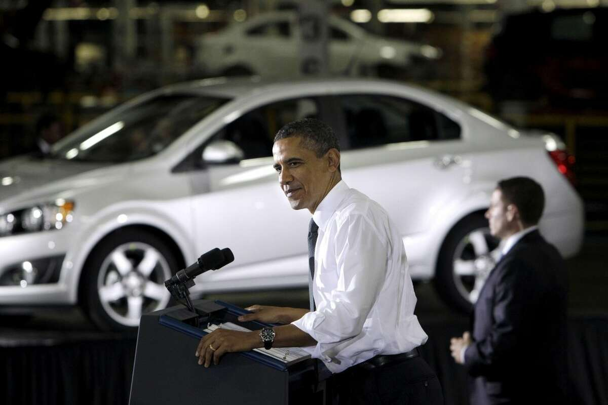 In this Friday, Oct. 14, 2011, file photo, President Barack Obama speaks at the General Motors Orion assembly plant in Orion Township, Mich. The U.S. government said Wednesday, Dec. 19, 2012, that it will sell its remaining stake in General Motors in the next year or so, winding down a $50 billion bailout that saved the iconic American car giant but also set off a heated debate about government intervention in private business that influenced this year�s presidential election. (AP Photo/Carlos Osorio, File)