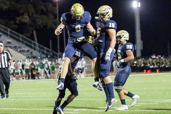 Klein Collins quarterback Bryson Powers (8) celebrates with Tyler Spillman (15) after scoring a touchdown in a high school football game at on Friday, October 21, 2016, in Klein.