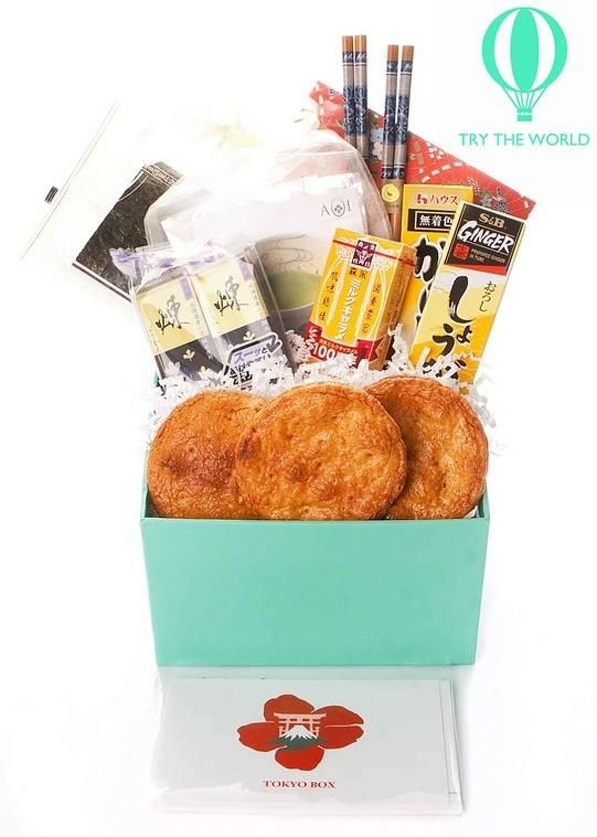 This handout product image provided by trytheworld.com shows the company's subscription offering. Trytheworld.com sends subscribers a box of hard-to-find items like jams, fine teas and films from a different city (Paris, Tokyo and Rio) every two months for a $45 fee for each box. (AP Photo/Trytheworld.com)