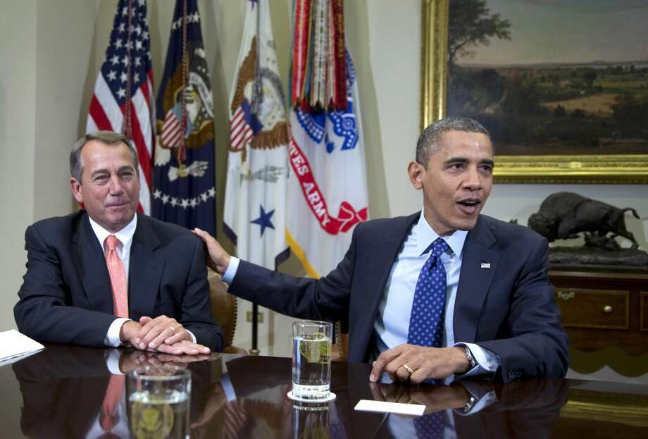 In this Friday, Nov. 16, 2012, file photo, President Barack Obama acknowledges House Speaker John Boehner of Ohio while speaking to reporters in the Roosevelt Room of the White House in Washington. U.S. stocks shook off their post-election slump Monday and recorded big gains as investors appeared more optimistic about a deal to avoid a federal budget crisis and were encouraged by a pair of corporate earnings reports. (AP Photo/Carolyn Kaster)