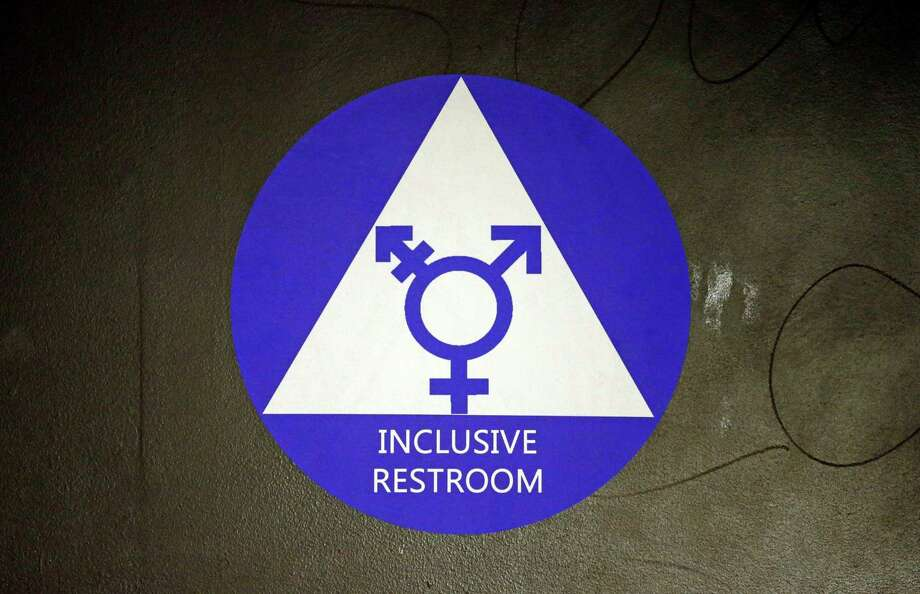 FILE - In this May 17, 2016, file photo, a new sticker designates a gender neutral bathroom at Nathan Hale high school in Seattle. A federal judge in Texas is blocking for now the Obama administration's directive to U.S. public schools that transgender students must be allowed to use the bathrooms and locker rooms consistent with their chosen gender identity. (AP Photo/Elaine Thompson, File) Photo: Elaine Thompson, STF / Copyright 2016 The Associated Press. All rights reserved. This material may not be published, broadcast, rewritten or redistribu