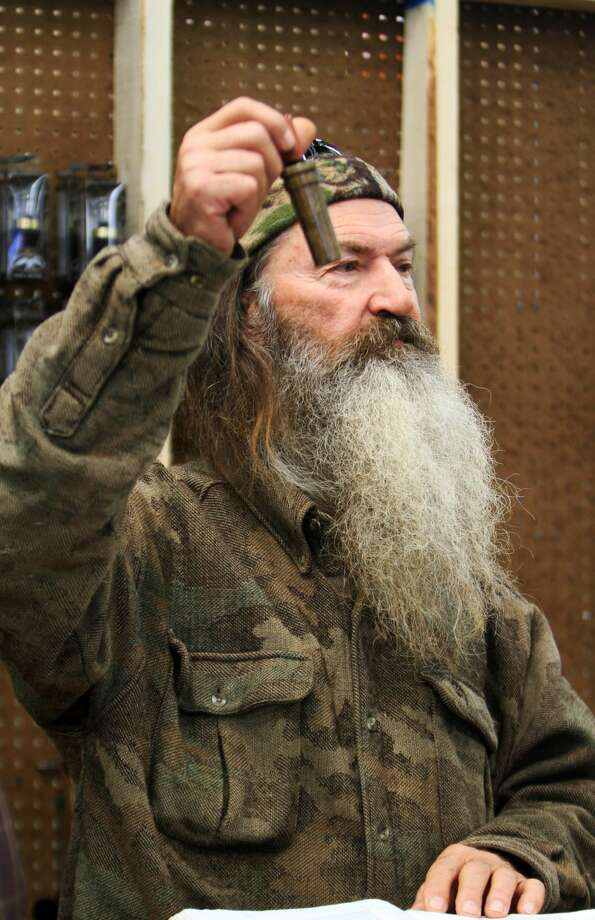 "This Nov. 7, 2013 file photo shows Phil Robertson, the Duck Commander, holding the 1 millionth duck call assembled for 2013 at company's warehouse in West Monroe, La. The A&E channel says ""Duck Dynasty"" patriarch Robertson is off the show indefinitely after condemning gays as sinners in a magazine interview. In a statement Wednesday, Dec. 18, 2013, A&E said it was extremely disappointed to read Robertson's comments in GQ magazine. (AP Photo, The News-Star/Margaret Croft)"
