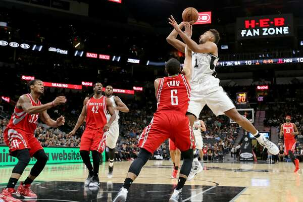 San Antonio SpursÕ Kyle Anderson shoots over Houston RocketsÕ Tyler Ennis during first half action of their preseason game held Friday Oct. 21, 2016 at the AT&T Center.