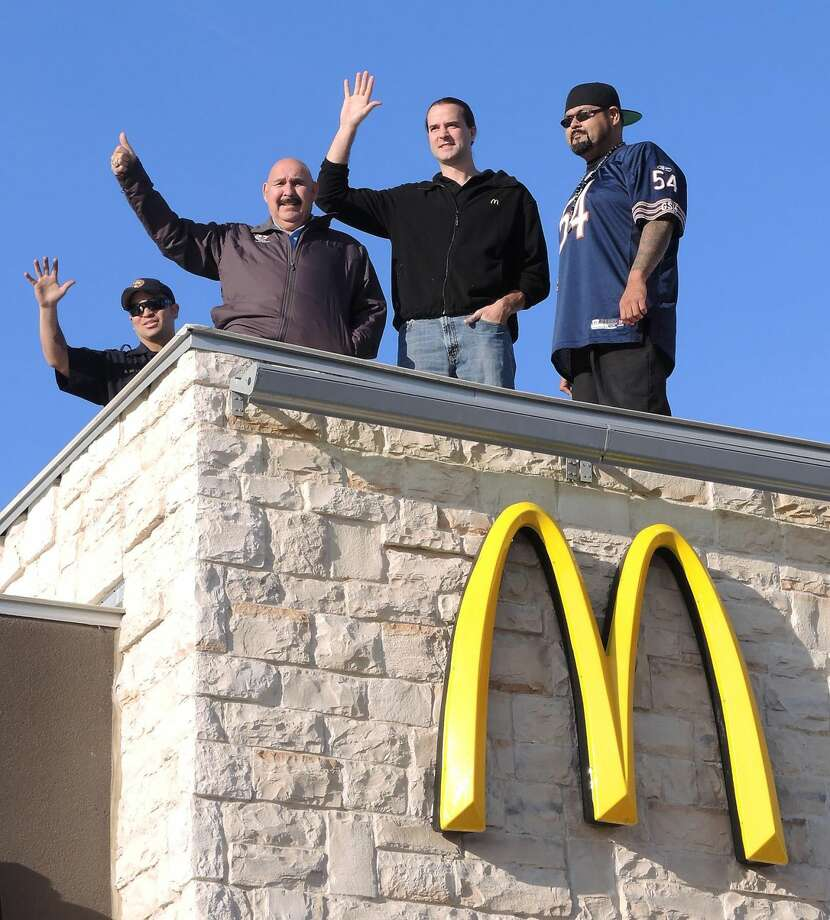 "'Up on the rooftop reindeer pause'Mayor Raul Salinas, second from left, is joined by firefighter Alfredo de la Cruz, McDonald's Mike Marasco and Guerra Communications DJ Pete ""The Heat"" Martinez stand atop the roof of the McDonald's restaurant at the corner of McPherson Road and Del Mar Boulevard on Tuesday. The group will stay on the roof until Thursday afternoon to collect toys and supplies for needy children and the elderly of Laredo. (Photo by Cuate Santos/Laredo Morning Times)"
