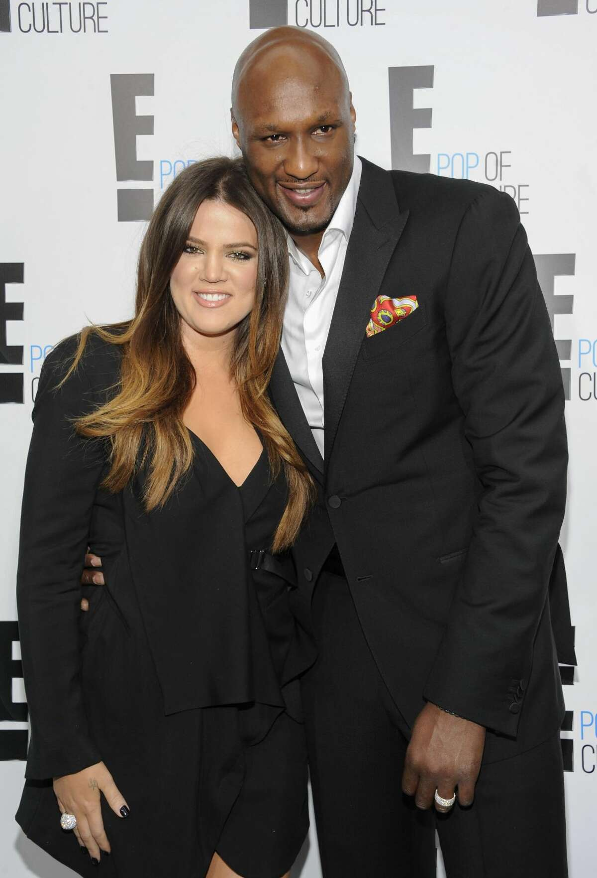 FILE - This April 30, 2012 file photo shows TV personality Khloe Kardashian Odom and professional basketball player Lamar Odom from the show