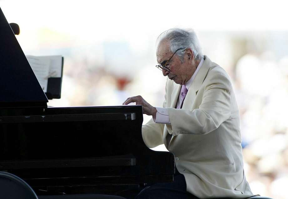 In this Aug. 8, 2010 file photo, composer Dave Brubeck plays at his last appearance at the Newport Jazz Festival in Newport, R.I. Brubeck died in Connecticut Wednesday morning, Dec. 5, 2012, of heart failure after being stricken while on his way to a cardiology appointment with his son Darius. Brubeck would have turned 92 on Thursday, Dec. 6 (AP Photo/Joe Giblin, File)