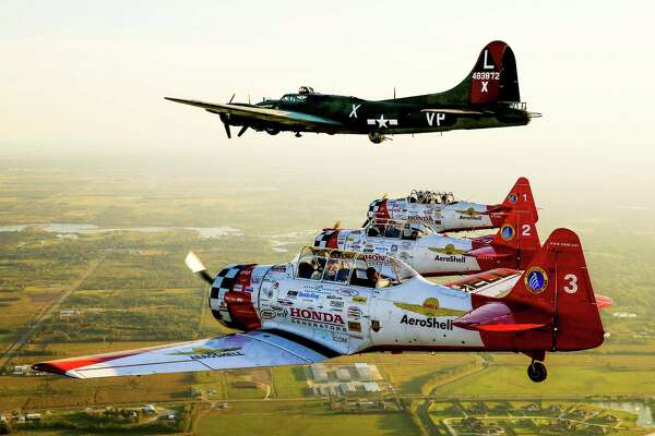 The Aeroshell Acrobatic Team flies with a B-17 bomber during a practice flight before this weekend's Wings Over Houston airshow at Ellington Field Friday, Oct. 21, 2016 in Houston.