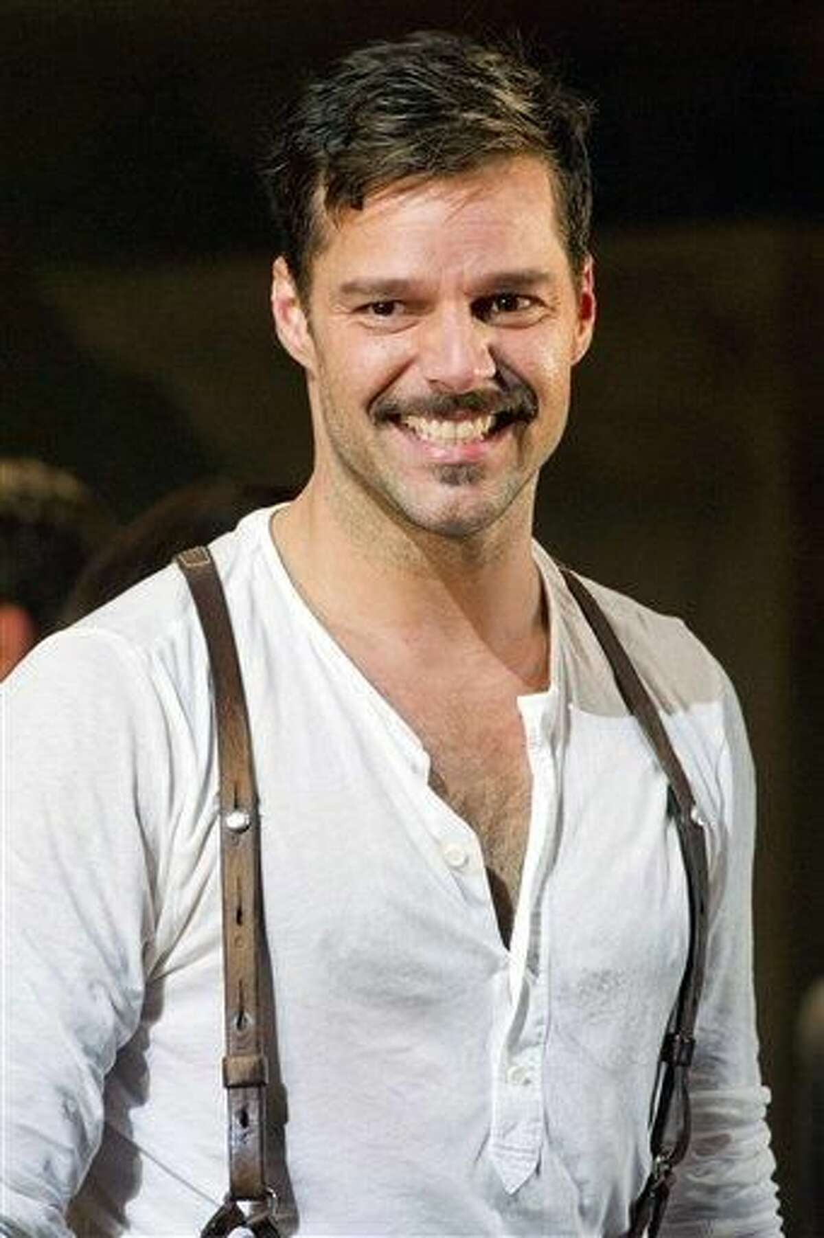 In this Monday, March 12, 2012 photo, Ricky Martin appears at the curtain call after his first performance in the new Broadway production of