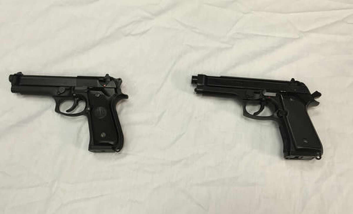FILE - This April 28, 2016, file photo shows a semi-automatic handgun, left, next to a Powerline 340 BB gun, right, similar to a BB gun authorities say a teenager carried when he was shot and wounded by a Baltimore police officer, displayed during a news conference in Baltimore. As Ohio authorities investigate the fatal police shooting Wednesday, Sept. 14, 2016, of Tyre King, who officers said pulled a realistic-looking BB gun from his waistband, law enforcement agencies are grappling with toy or replica firearms used in real crimes. (AP Photo/Juliet Linderman, File)