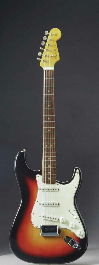 In this undated photo provided by Christie's Auction House, the Fender Stratocaster a young Bob Dylan played at the historic 1965 Newport Folk Festival is shown. The festival was a defining moment that marked Dylan's move from acoustic folk to electric rock 'n' roll. The guitar can bring as much as $500 thousand when it goes up on the block at Christie's on Friday, Dec. 6, 2013. (AP Photo/Christie's Auction House, File)