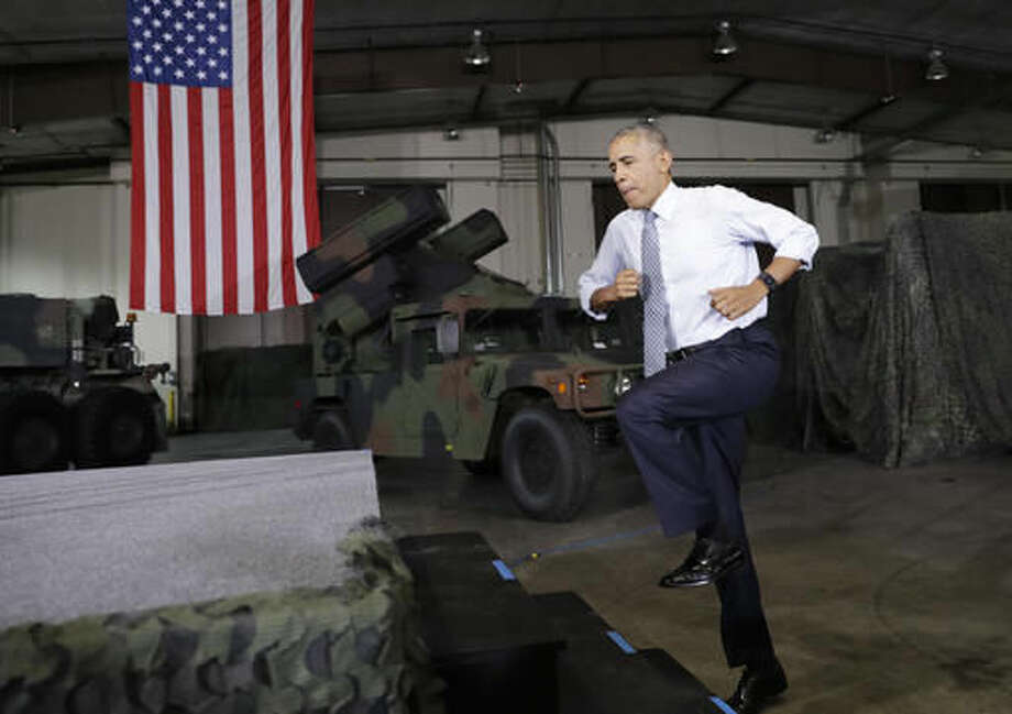 President Barack Obama jumps up the stairs to take the stage to speak to members of the military community, Wednesday, Sept. 28, 2016, in Fort Lee, Va. (AP Photo/Carolyn Kaster)