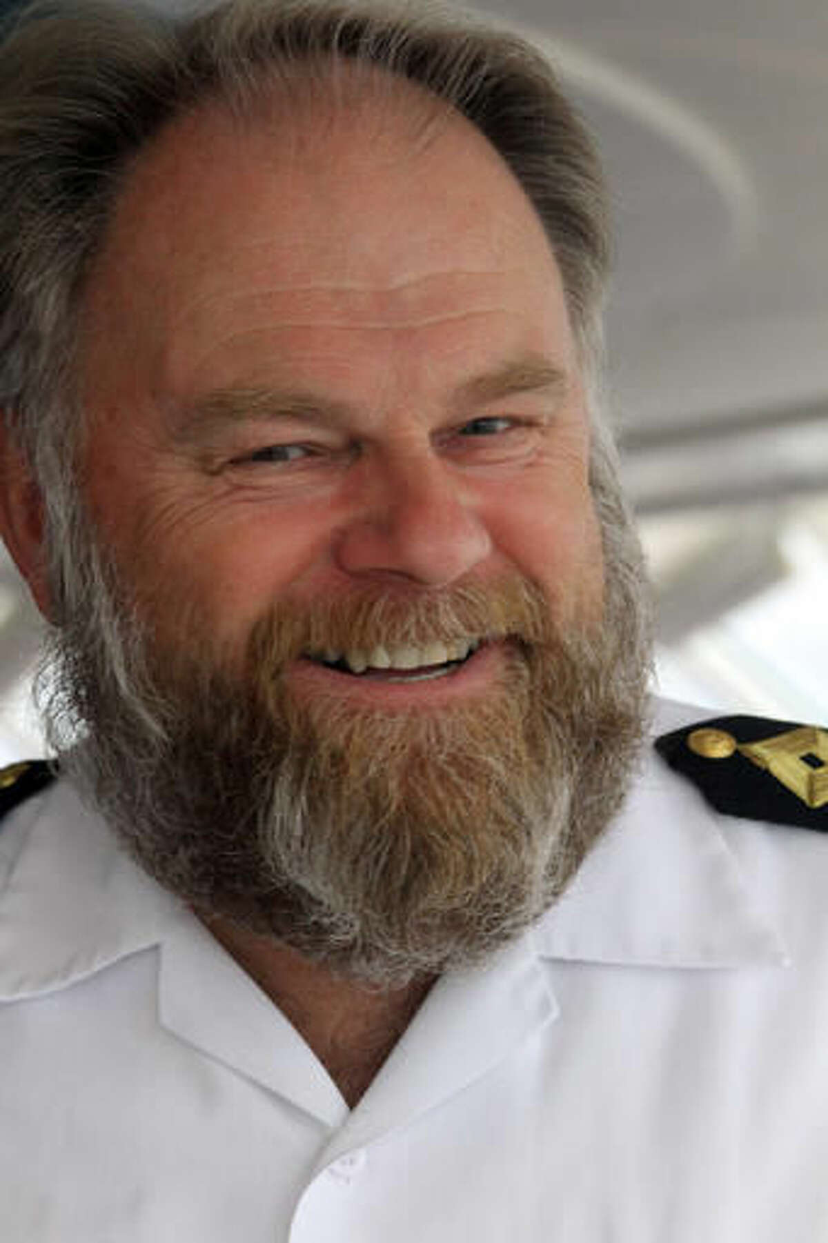This Aug. 21, 2016, photo shows Birger Vorland, the captain of the cruise ship Crystal Serenity, speaking to reporters while the ship was anchored in the Bering Sea just off Nome, Alaska. The luxury liner was not only the largest ever to visit Nome but the biggest to go through the Northwest Passage. (AP Photo/Mark Thiessen)