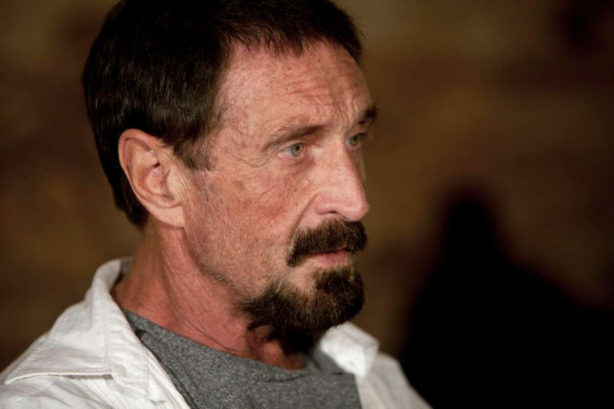 In this Dec. 4, 2012, file photo, software company founder John McAfee listens to a question during an interview at a local restaurant in Guatemala City. McAfee said Sunday, Dec. 9, 2012, a live-stream Internet broadcast from the Guatemalan detention center where he is fighting a government order that he be returned to Belize, that he wants to return to the United States and