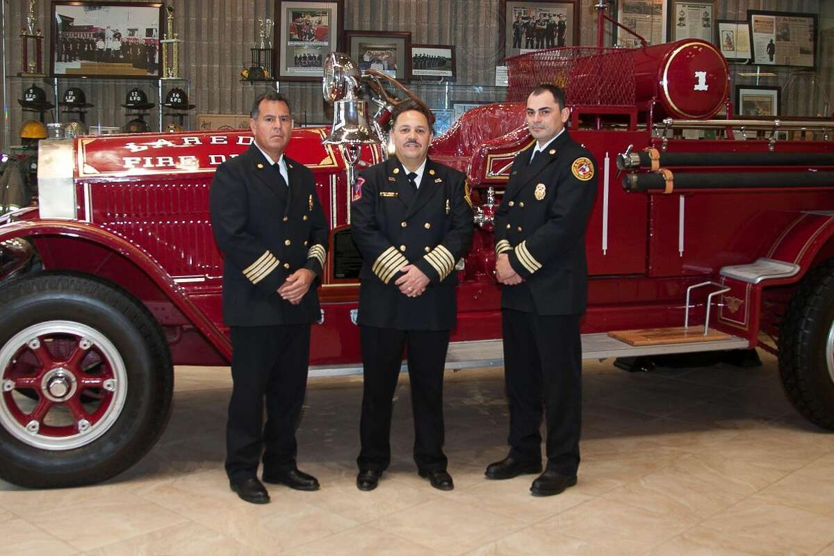 Antonio Gariby, left, and Ramiro Elizondo, right, pose with Laredo Fire Department Chief Steve Landin. Garibay was promoted to assistant fire chief and Elizondo was promoted to deputy chief following the retirement of Assistant Fire Chief David Piton. (Courtesy photo)