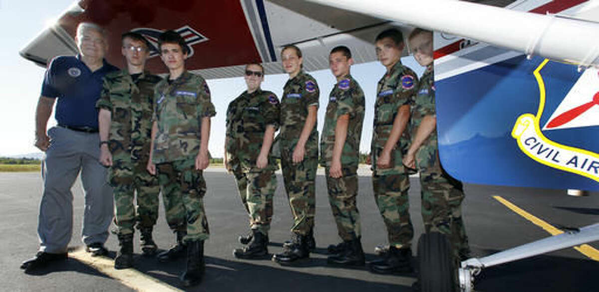 In this photo taken Wednesday Sept. 7, 2016 squadron Commander Allen Strasser poses with a group of Civil Air Patrol cadets in Whitefield, N.H. A renewed interest in flying has led to the return of a volunteer Civil Air Patrol unit in northern New Hampshire. (AP Photo/Jim Cole)